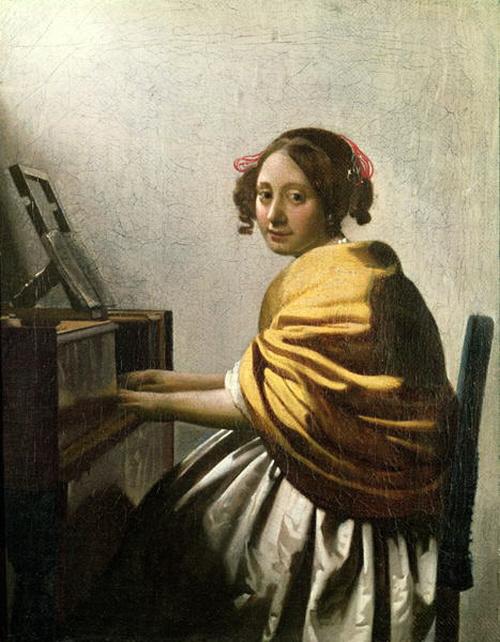 Young woman seated at a virginal